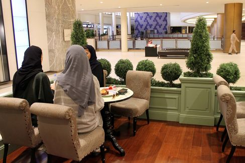 Saudi women wear colored abayas while lunching in Centria Mall in Riyadh on Aug. 23.