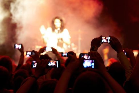 Put Down Your Smartphones and Enjoy the Show