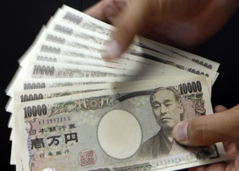 Japan Follows Switzerland in Seeking to Stem Currency Gains