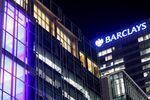 Lights shine from Barclays Plc head offices at the Canary Wharf business, financial and shopping district in London, U.K.