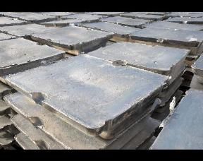 Aluminum ingots are stacked outside for cooling