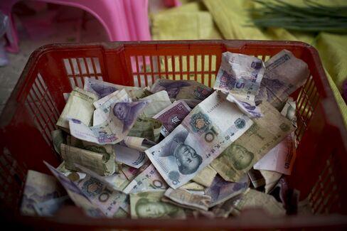 Yuan Slump Spells Buying Opportunity for Schroder: