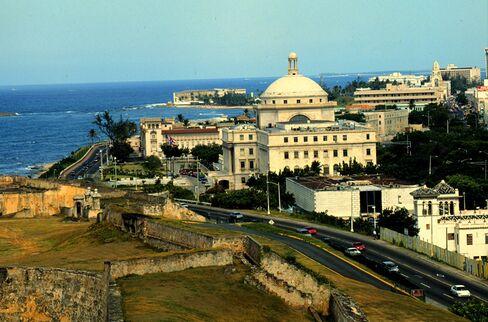 John Paulson Says Puerto Rico Will Be Singapore of Caribbean
