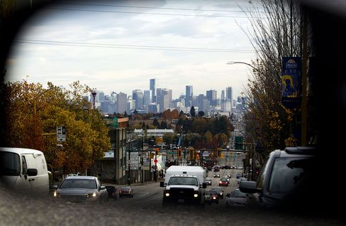 Traffic and buildings are reflected in the rear view mirror of a vehicle in Vancouver.