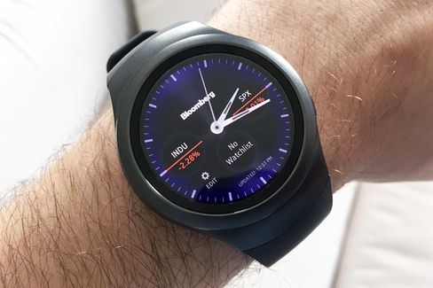 A stock-tracking Bloomberg watch face on the Gear S2.