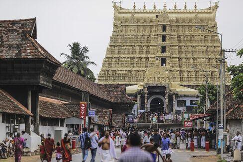 Devotees outside the Sree Padmanabhaswamy temple in Trivandrum, India. Photographer: Dhiraj Singh/Bloomberg