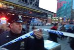 Police respond to a report of an explosion near Times Square on .. (AP Photo/Charles Zoeller)