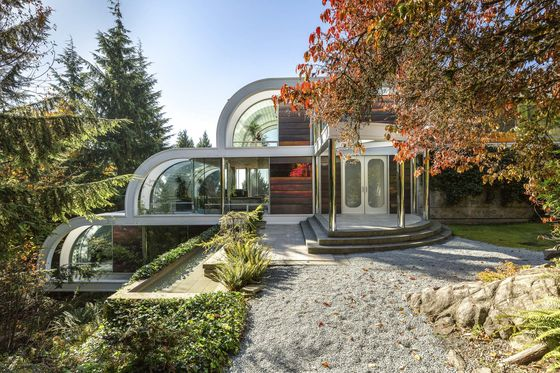This $12.8 MillionCanadian Mansion Is a Waterfall of Steel and Chrome