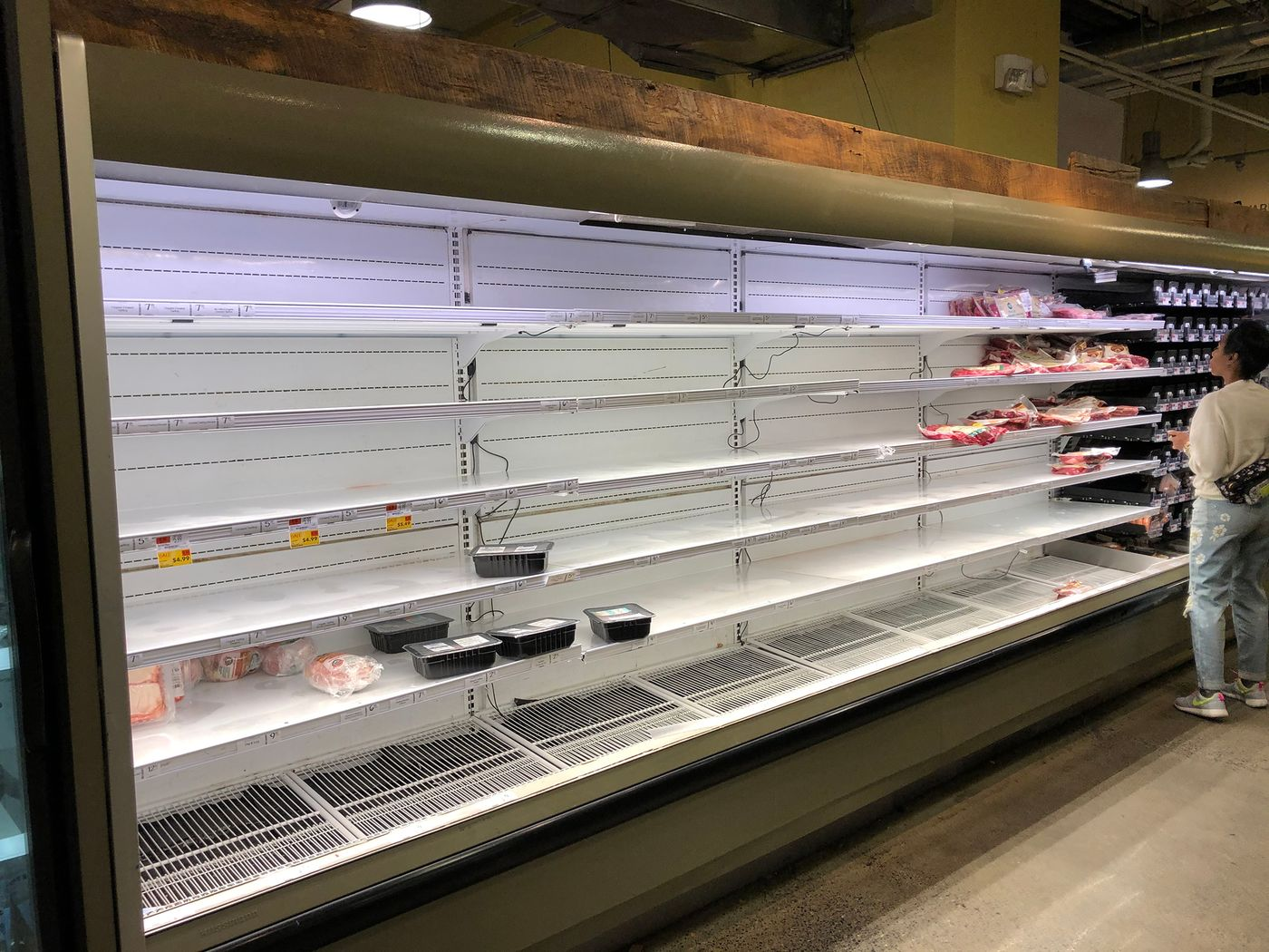 relates to Americans Empty Nation's Grocery Shelves to Hunker Down at Home