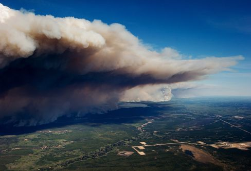 Smoke rises over Fort McMurray on May 6.