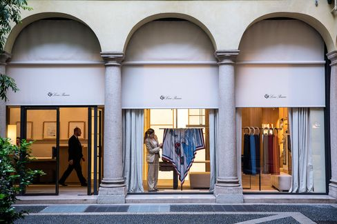 A Loro Piana employee adjusts a window display at a company store in Milan.