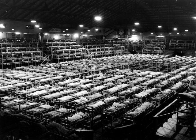 Men's dormitory in Forum building, Building K, during Japanese Canadian internment and relocation, 1942