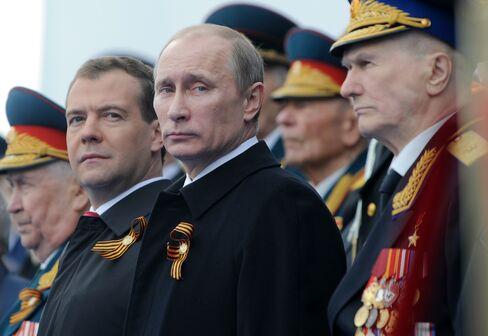 Russia's Vladimir Putin and Dmitry Medvedev