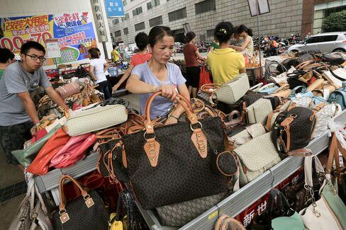 Wen's Slowdown Challenge Deepens as China Retailers Lose Steam
