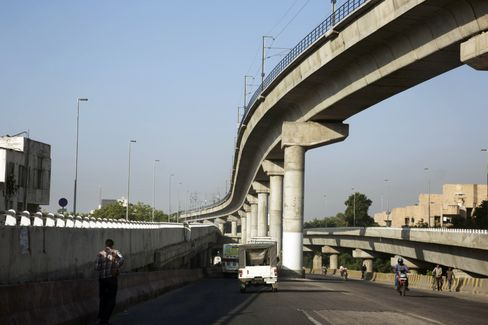 Vehicles travel along a highway in Jaipur