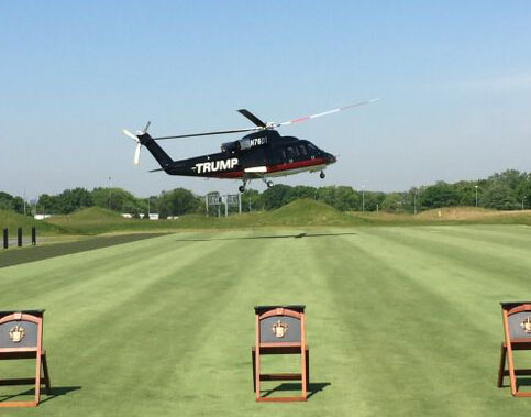 An empty helicopter arrives at the opening ceremonies.