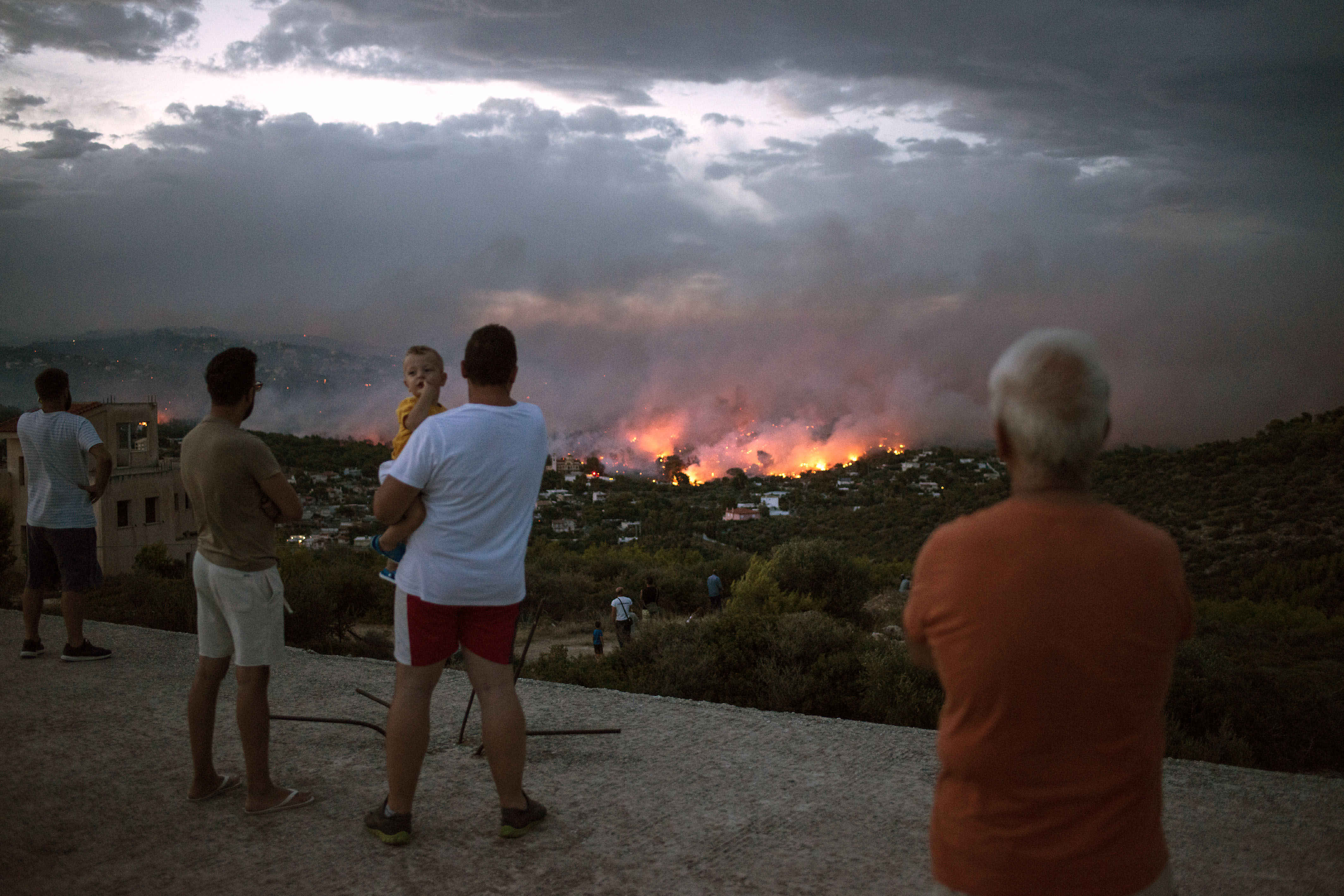 Residentswatch a wildfire in the town of Rafina, near Athens, Greece inJuly 2018. Mediterranean nations have spent around 200 billion euros in the past two decades to build up some of the world's largest firefighting forces.