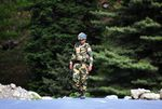An Indian Border Security Force soldier walks near a check post along the Srinagar-Leh National highway on June 16, 2020.