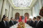 Donald Trump, Xi Jinping, and members of their delegations during their bilateral meeting on Dec. 1.
