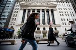 Pedestrians pass in front of Wall Street near the New York Stock Exchange (NYSE) in New York, U.S., on Monday, Oct. 22, 2018.