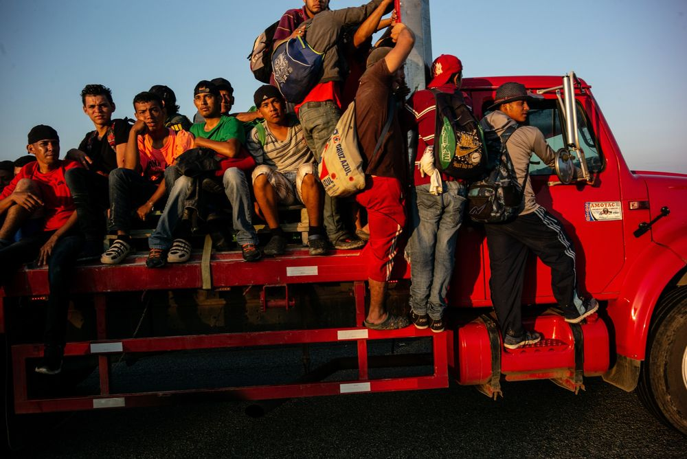 Central American refugees ride a cargo truck in Mexico.