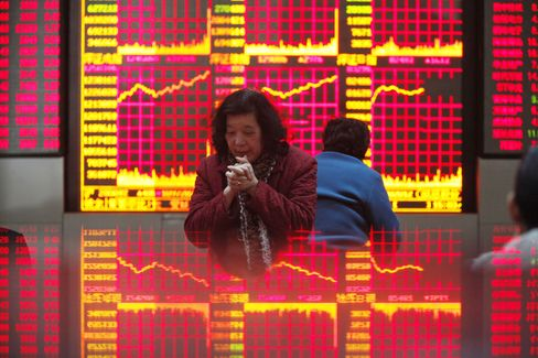 Most Chinese Stocks Rise After Central Bank Cuts Interest Rates