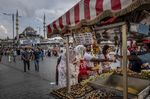 Customers purchase snacks from a mobile stall on Eminonu Square in Istanbul, Turkey,.