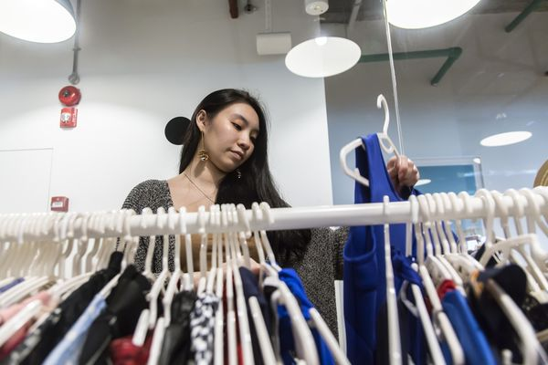 An employee sorts clothing. Image: Ore Huiying/Bloomberg