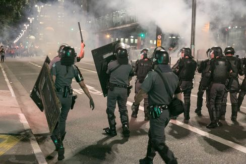 Police use tear gas to disperse the protesters marching through the Paulista Avenue during a rally in support of suspended President Dilma Rousseff in Sao Paulo on August 29.