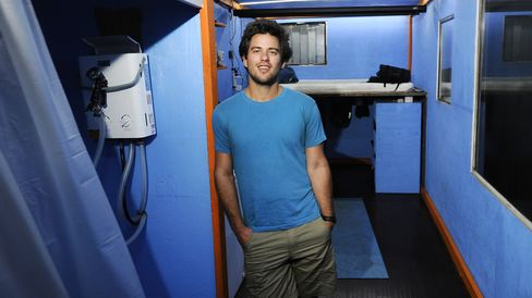 Luke Iseman inside his converted shipping container home. Photographer: Michael Short/Bloomberg