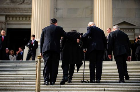 Vice President Joe Biden and Senator Joe Manchin assist Senator Mark Kirk up the steps of the U.S. Capitol on Jan. 3, 2013, as Kirk returnedto work for the first time since suffering a stroke the year before.