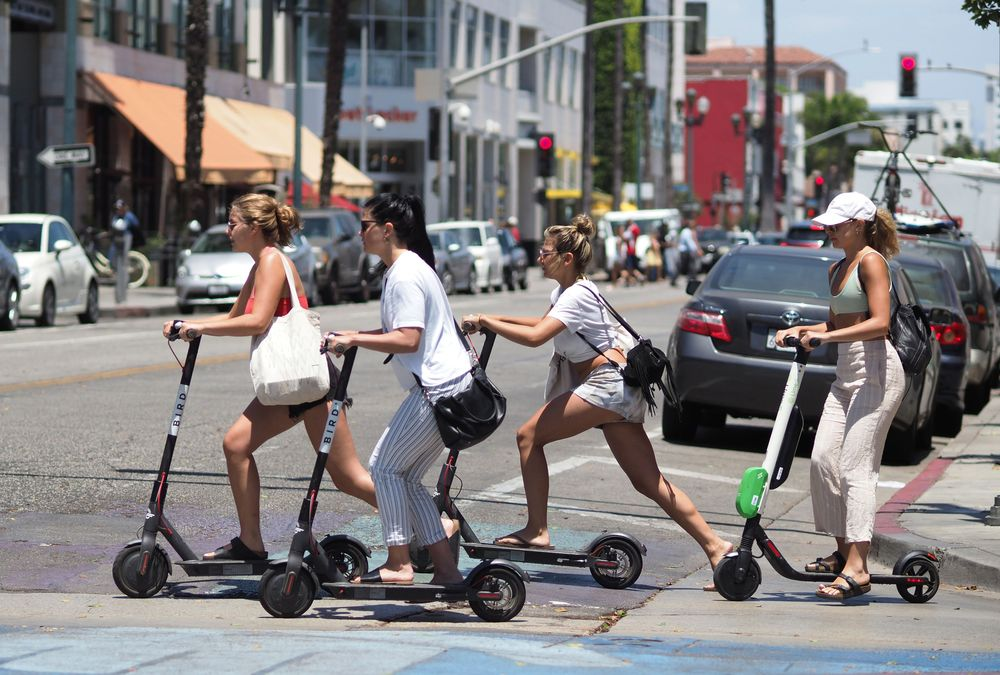 Electric-Scooter Mania Is Taking Over Cities - Bloomberg