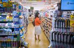 A woman holds a package of medicine inside a Cocokara Fine Inc. store in Tokyo.