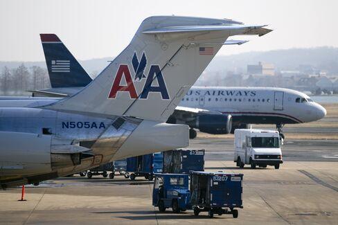 AMR, US Airways Leaders Defend Merger Called Bad for Fliers