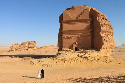 American tourist Birgit Mitchell visiting Mada'in Saleh, a UNESCO World Heritage Site, in Saudi Arabia, with her guide Yasser Al Imam. on Tuesday, Jan. 31, 2017. XXX ADD SECOND SENTENCE HERE XXX. Photographer: Vivian Nereim/Bloomberg