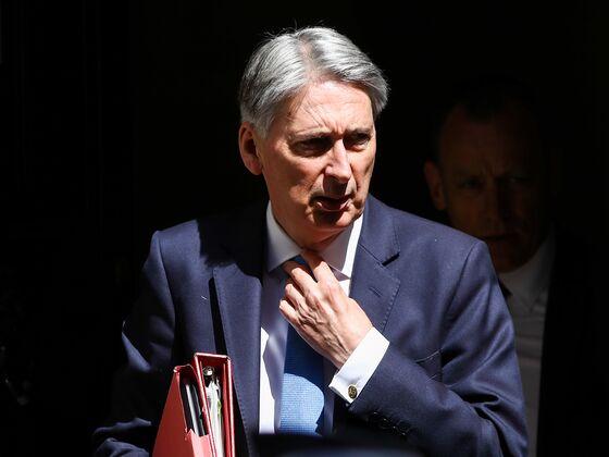 No-Deal Brexit May Prolong U.K. Austerity, Hammond Says