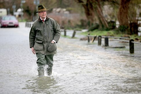 Political Tempers Flare as British Floodwaters Rise