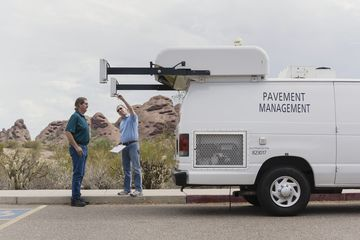 City of Phoenix Pavement Management workers Jim Williams (left) and Todd Nunn (right) check one of the external cameras on the Pavement Management van during recent stop in Papago Park in Phoenix, Arizona.