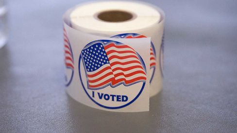 A roll of 'I Voted' stickers, which are handed out to residents after they vote, sit on an election officials table at a polling place on November 4, 2014 in Ferguson, Missouri.