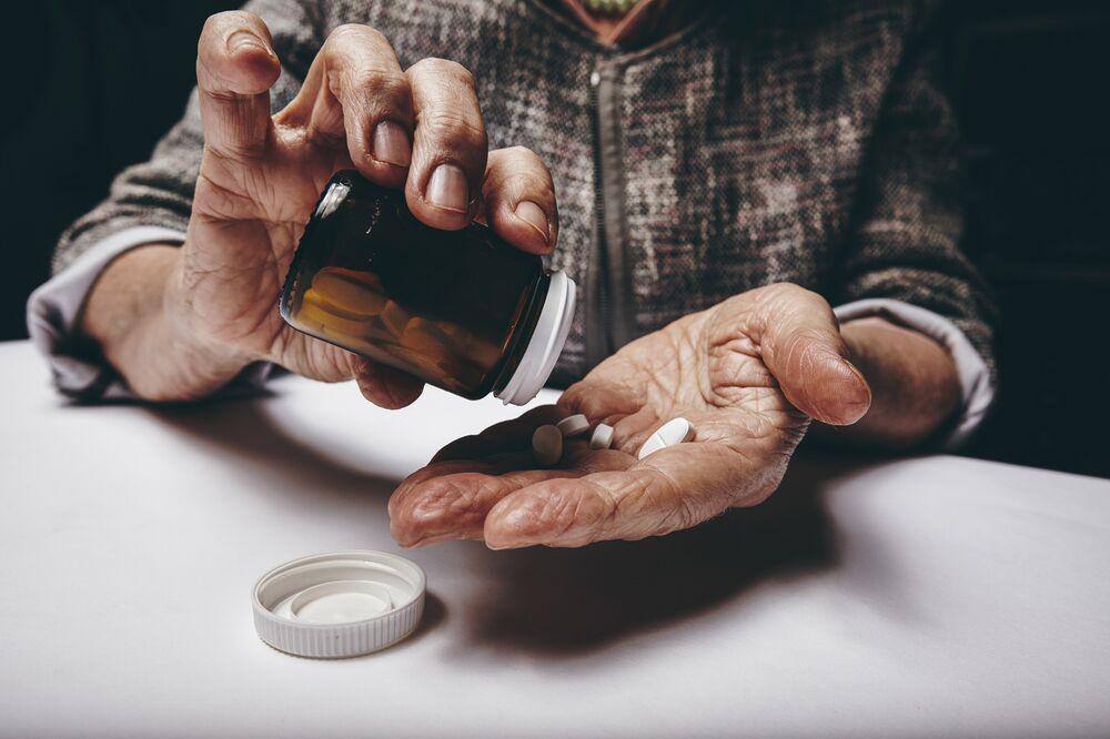 Woman taking prescription medicine