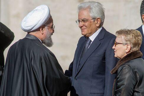Italy's president Sergio Mattarella, second right, greets Hassan Rouhani in Rome.