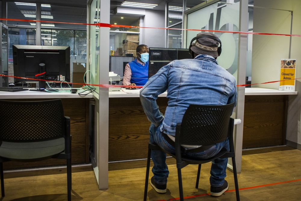 Tape sits across a service counter to enforce social distancing during a coronavirus measures inspection visit at the City of Johannesburg customer service centeron July 28.