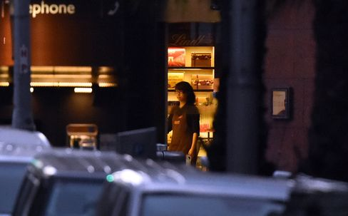 Hostages Held in Darkness as Sydney Cafe Siege Passes 12th Hour