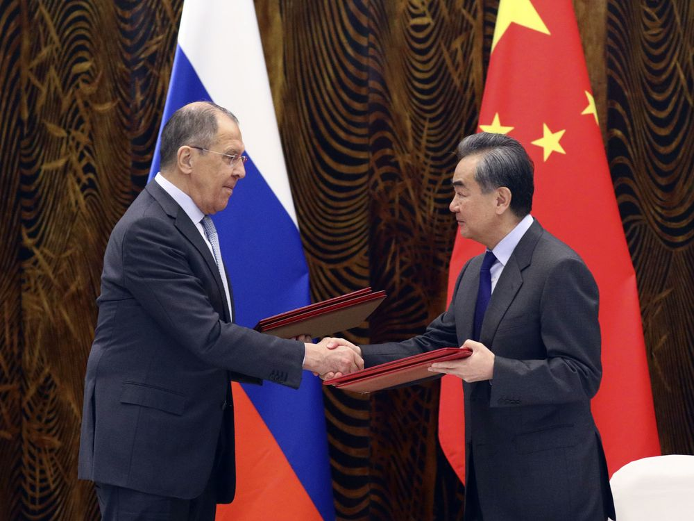 Wang Yi, right, and Sergei Lavrov during a signing ceremony in Beijing, on March 23.