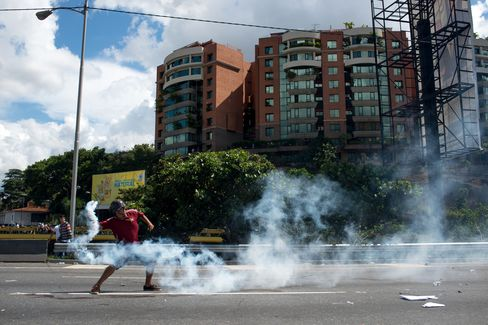 An opposition supporter clashes with police during a protest in Caracas on Sept. 1.