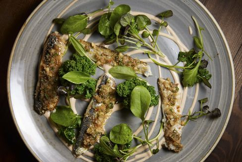 Herrings and sardines, with pine nut milk and greens.