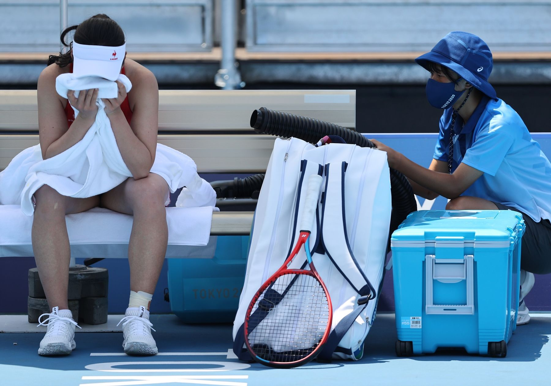 Nao Hibino of Team Japan attempts to cool down between games during her Women's Singles First Round match against Nina Stojanovic of Team Serbia on day one of the Tokyo 2020 Olympic Games at Ariake Tennis Park in Tokyo, onJuly 24