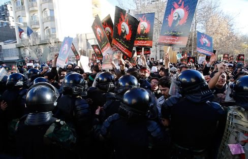 Police clash with protestors during a demonstration near the Saudi Arabian embassy in Tehran, on Jan. 3, 2016.