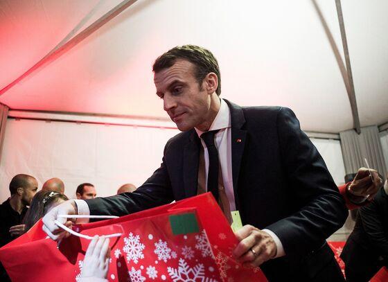 Macron's Little Helper CEOs Spread Holiday Cheer With Bonuses
