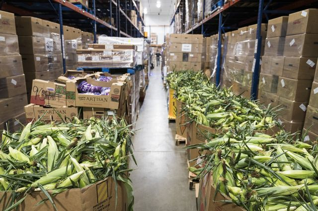 Boxes of corn are sorted in the refrigerated unit at the headquarters of hunger-relief group Second Harvest Heartland in Brooklyn Park, Minnesota, on July 23, 2020.